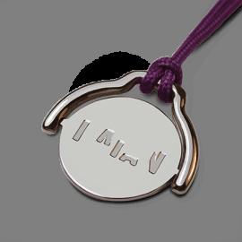 Pendentif mobile ENIGMA en or blanc 750 millièmes rhodié et cordon violette de la collection de bijoux pour enfants MIKADO.