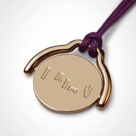 Pendentif mobile ENIGMA en or jaune 750 millièmes et cordon violette de la collection de bijoux pour enfants MIKADO.