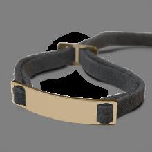 Bracelet SKIN en or jaune 750 millièmes et daim gris de la collection de bijoux pour enfants MIKADO.