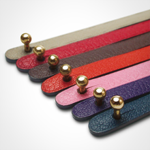 Ball clasp in 750 yellow gold and leather strap color chart by MIKADO jewellery collection for kids.