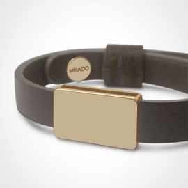 HIP HOP bracelet in 750 yellow gold and chocolate leather strap by MIKADO jewellery collection for kids.