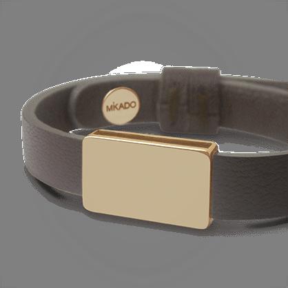 Bracelet HIP HOP en or jaune 750 millièmes et cuir chocolat de la collection de bijoux pour enfants MIKADO.