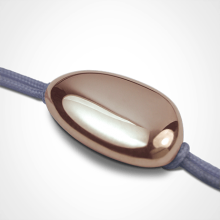 LA DRAGÉE christening bracelet in 750 pink gold and lavender chord by the jewellery collection for children MIKADO.