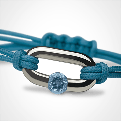NEWBORN blue topaz bracelet in 925 silver and ocean blue cord by the jewellery collection for children MIKADO.