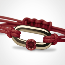 NEWBORN garnet bracelet in 750 yellow gold and cherry cord by the jewellery collection for children MIKADO.