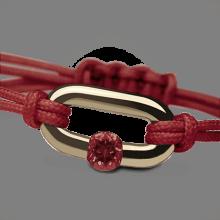 Bracelet NEWBORN grenat en or jaune 750 millièmes et cordon cerise de la collection de bijoux pour enfants MIKADO.
