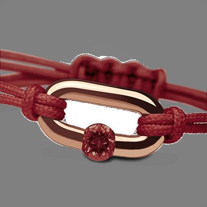 Pulsera NEWBORN granate en oro rosa de 750 milésimas y cordón de cereza de la colección de joyería infantil MIKADO.
