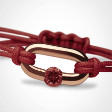NEWBORN garnet bracelet in 750 pink gold and cherry cord by the jewellery collection for children MIKADO.