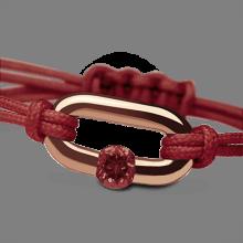 Bracelet NEWBORN grenat en or rose 750 millièmes et cordon cerise de la collection de bijoux pour enfants MIKADO.