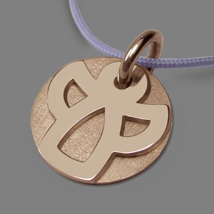 Medalla de bautismo ANGIE en oro rosa 750 milésimas rodiadas y cordón de lavanda de la colección de joyería infantil MIKADO.